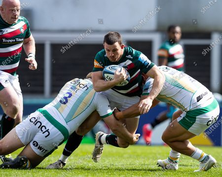 Matt Scott of Leicester Tigers is double-tackled