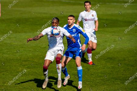 Stock Image of Northampton Town forward Mickel Miller (14) and Gillingham FC midfielder Stuart O'Keefe (4) during the EFL Sky Bet League 1 match between Gillingham and Northampton Town at the MEMS Priestfield Stadium, Gillingham