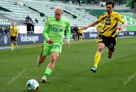 Stock Picture of Wolfsburg's Xaver Schlager (L) in action against Dortmund's Thomas Delaney (R) during the German Bundesliga soccer match between VfL Wolfsburg and Borussia Dortmund in Wolfsburg, Germany, 24 April 2021.