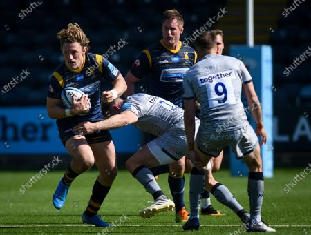 Stock Picture of Tom Howe of Worcester Warriors is tackled