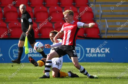 Nicky Maynard of Newport County gets in a cross under pressure from Jack Sparkes of Exeter City