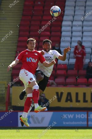 Nathan Thompson Peterborough United battles in the air with Liam Millar of Charlton Athletic