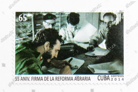 Fidel Castro in vintage 'Cuba Correos' postal stamp. 55th Anniversary of the Agrarian Reform. Year 2014