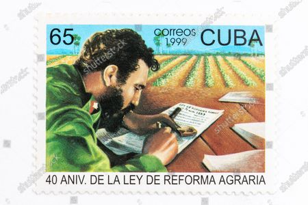 Fidel Castro in vintage 'Cuba Correos' postal stamp. 40th Anniversary of the Agrarian Reform. Year 1999