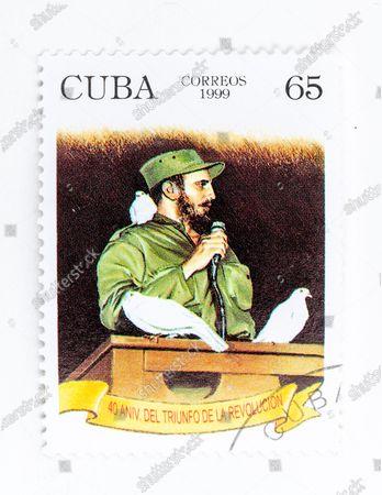 Fidel Castro in vintage 'Cuba Correos' postal stamp. 40th Anniversary of the Triumph of the Revolution. Year 1999