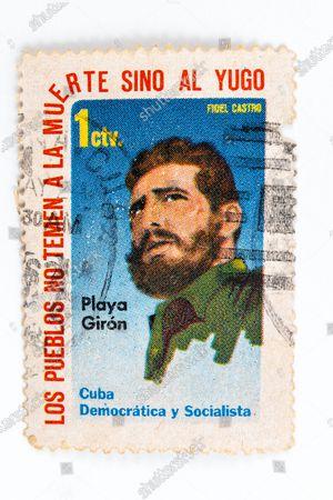 Fidel Castro in vintage 'Cuba Correos' postal stamp. 'Playa Giron' or Bay of Pigs. Democratic Socialist Cuba.