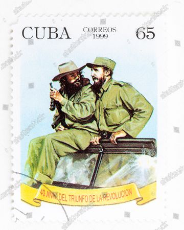 Fidel Castro in vintage 'Cuba Correos' postal stamp. He appears alongside Camilo Cienfuegos. 40th Anniversary of the Triumph of the Cuban Revolution. Year 1999
