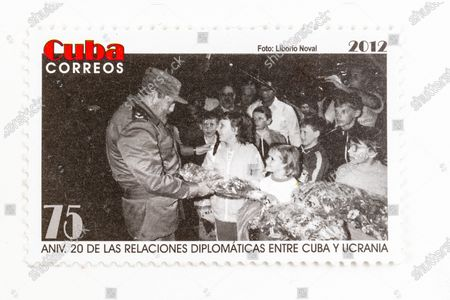 Fidel Castro in vintage 'Cuba Correos' postal stamp. 20th Anniversary of Diplomatic Relations between Cuba and Ukraine.