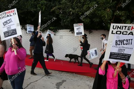 Local 11 members and allies demonstrate outside Chateau Marmont where more than 200 workers were fired as a result of the economic fallout of the COVID-19 pandemic in Hollywood on Friday, April 23, 2021 in Los Angeles, CA. This action comes a day after Oscar-Nominated Director Aaron Sorkin pulled filming at the hotel due to the ongoing labor dispute. (Dania Maxwell / Los Angeles Times)