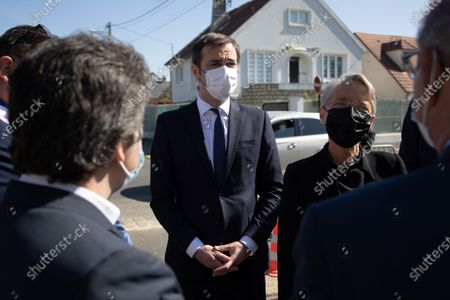 French Minister for Solidarity and Health Olivier Veran and French Labor Minister Elisabeth Borne arrives to visit the vaccination center in Sainte-Genevieve-des-Bois