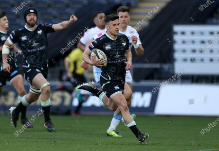 Stock Image of Matthew Aubrey of Ospreys runs in to score a try.
