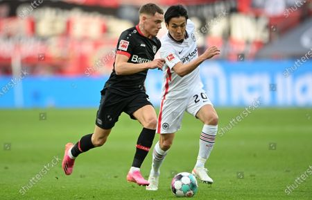 Stock Picture of Leverkusen's Florian Wirtz (L) in action against Frankfurt's Makoto Hasebe (R) during the German Bundesliga soccer match between Bayer 04 Leverkusen and Eintracht Frankfurt in Leverkusen, Germany, 24 April 2021.