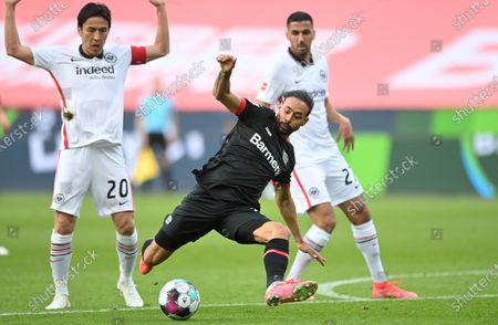 Frankfurt's Makoto Hasebe (L) in action against Leverkusen's Karim Bellarabi (C) during the German Bundesliga soccer match between Bayer 04 Leverkusen and Eintracht Frankfurt in Leverkusen, Germany, 24 April 2021.