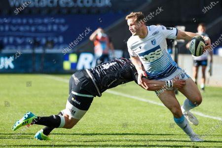 Stock Image of Hallam Amos of Cardiff Blues offloads as he is tackled by George North of Ospreys
