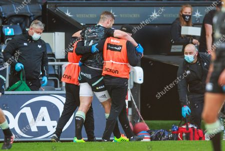 Stock Photo of George North of Ospreys leaves the pitch injured