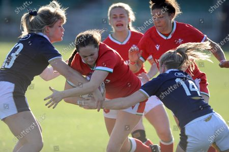 Caitlan Lewis - Wales winger drives into Hannah Smith - Scotland centre and Liz Musgrove.