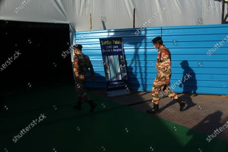 Stock Picture of Indo-Tibetan Border Police (ITBP) personnel walk past the campus hall of spiritual organisation Radha Soami Satsang Beas, converted into Sardar Patel COVID Care Centre, amidst the rising coronavirus cases in New Delhi, India. The national capital logged 24,331 fresh COVID-19 cases and a record single-day jump of 348 deaths on Friday, according to the latest health bulletin.