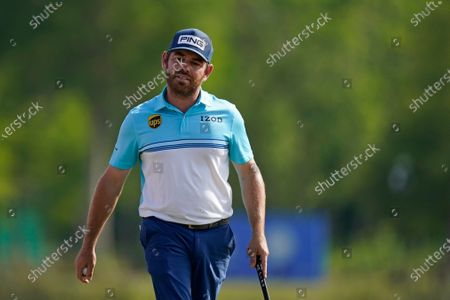 Louis Oosthuizen of South Africa reacts after missing an eagle putt on the 18th green during the third round of the PGA Zurich Classic golf tournament at TPC Louisiana in Avondale, La