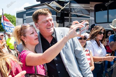 Stock Picture of Patrick Byrne takes a selfie with fans at the Save America Patriot Rally on April 24, 2021 in Bradenton, FL.