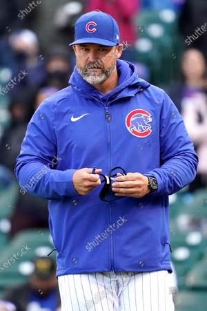 Chicago Cubs manager David Ross walks to the dugout after he was ejected by umpire Cory Blaser during the ninth inning of a baseball game against the Milwaukee Brewers in Chicago