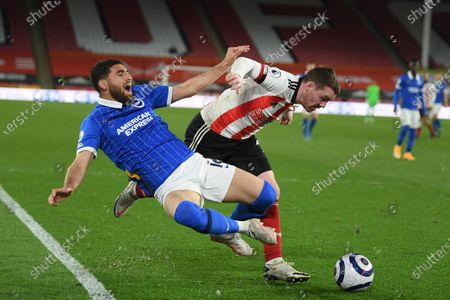 Brighton's Alireza Jahanbakhsh, left and Sheffield United's John Fleck challenge for the ball during an English Premier League soccer match between Sheffield United and Brighton Hove Albion at the Bramall Lane stadium in Sheffield, England