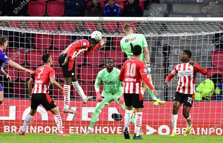 Groningen's goalkeeper Sergio Padt (C-R) in action against Eindhoven players Ibrahim Sangare (2-L), goalkeeper Yvon Mvogo (back), and Denzel Dumfries (R) during the Dutch Eredivisie soccer  match between PSV Eindhoven and FC Groningen in Eindhoven, Netherlands, 24 April 2021.