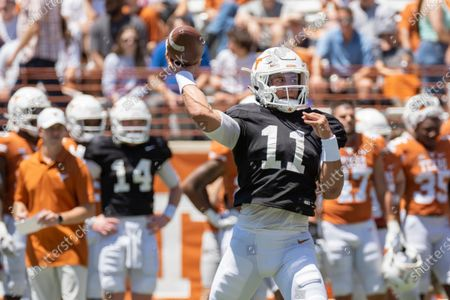 Texas quarterback Casey Thompson warms up before the Texas Orange and White Spring Scrimmage football game in Austin, Texas