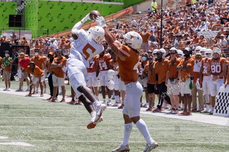 Texas defensive back D'Shawn Jamison (5) intercepts a pass intended for running back Jordan Whittington during the second half of the Texas Orange and White Spring Scrimmage football game in Austin, Texas