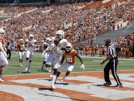 Texas defensive back Chris Adimora intercepts a pass in the end zone during the first half of the Texas Orange and White Spring Scrimmage football game in Austin, Texas
