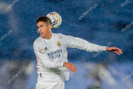 Real Madrid's Raphael Varane heads for the ball during the Spanish La Liga soccer match between Real Madrid and Betis at the Alfredo di Stefano stadium in Madrid, Spain