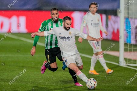 Stock Photo of Real Madrid's Dani Carvajal, front, vies for the ball with Betis' Borja Iglesias, left, during the Spanish La Liga soccer match between Real Madrid and Betis at the Alfredo di Stefano stadium in Madrid, Spain
