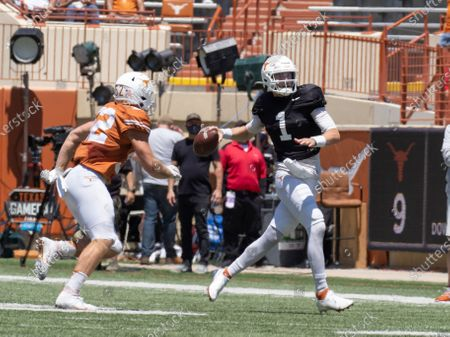 Texas quarterback Hudson Card (1) looks to pass against Texas linebacker Jett Bush (52) during the first half of the Texas Orange and White Spring Scrimmage football game in Austin, Texas