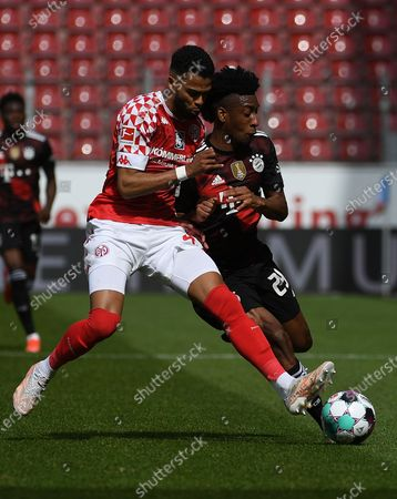 Jeremia St. Juste (FSV Mainz 05) Kingsley Coman (FC Bayern Muenchen) Zweikampf, Aktion, action, battle for the ball