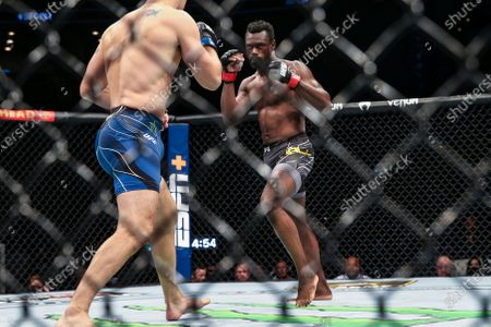Stock Photo of Uriah Hall, right, faces off against Chris Weidman just before blocking a kick from Weidman that broke Weidman's leg during a UFC 261 mixed martial arts bout, in Jacksonville, Fla
