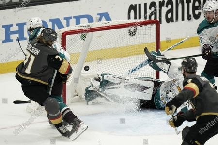 Vegas Golden Knights' William Karlsson, left, of Sweden, watches the puck enter the net for a goal against Anaheim Ducks goaltender John Gibson during the third period of an NHL hockey game, in Anaheim, Calif