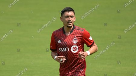 Toronto FC midfielder Marco Delgado (8) follows a play during the first half of an MLS soccer match against the Vancouver Whitecaps, in Orlando, Fla