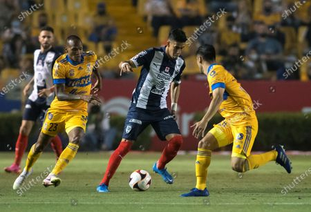 Stock Image of Luis Quinones (L) and Aldo Cruz (R) of Tigres UANL in action against Maximiliano Meza (C) Monterrey during a Guardians Clausura 2021 soccer tournament match at Estadio Universitario Monterrey, Mexico, 24 April 2021.
