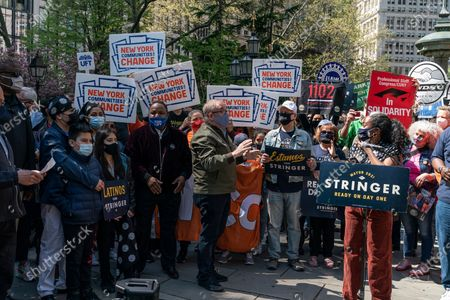 Scott Stringer (in green jacket) attends rally by coalition of union members and activists organized to support his bid for mayor at City Hall Park.