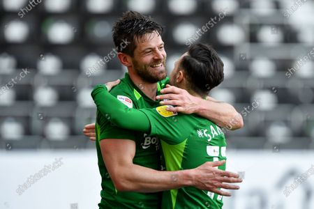 Lukas Jutkiewicz of Birmingham City celebrates with Ivan Sanchez of Birmingham City after scoring a goal to make it 1-2 during the Sky Bet Championship match between Derby County and Birmingham City at the Pride Park, Derby, UK on 24th April 2021.