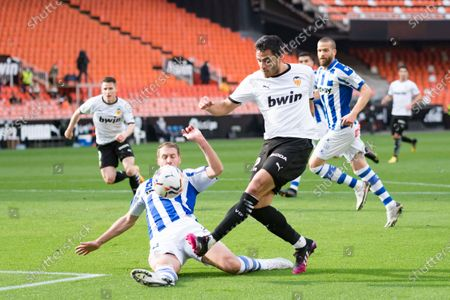 Maxi Gomez of Valencia CF and Florian Lejeune of Deportivo Alaves are seen in action during the Spanish La Liga football match between Valencia and Deportivo Alaves at Mestalla stadium. (Final score; Valencia CF 1:1 Deportivo Alaves)