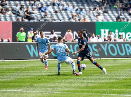 Calvin Harris (20) of FC Cincinnati controls ball during MLS regular game against NYCFC on Yankee stadium. NYCFC won their first home game of the season 5 - 0. Due to COVID-19 pandemic only 20% of capacity was allowed to be present at the stadium. Also all fans required to wear face masks and they were available at the entrance as well as sanitizers. Fans were seated with social distance. All fans were required to take a rapid antigen COVID-19 test and present a negative result in order to enter.