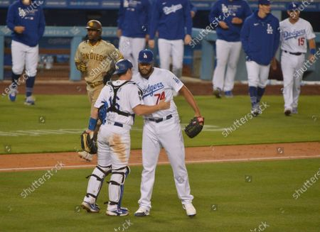 Stock Image of Los Angeles Dodgers' closing pitcher Kenley Jansen hugs catcher Will Smith after getting the save in the Dodgers 5-4 win over the San Diego Padres at Dodger Stadium in Los Angeles on Saturday, April 24, 2021. The much-maligned Jansen pitched the Dodgers out of a jam in the eighth inning and setting the Padres down in the ninth , including getting Fernando Tatis Jr. to ground out with a runner at second and striking out Trent Grisham to end it with a runner at third.  Photo by Jim Ruymen/UPI