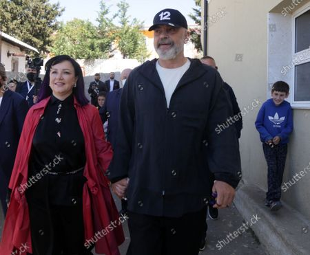 Albanian Prime Minister Edi Rama (R) and his wife Linda Rama (L) leave after casting their ballot at a polling station in Tirana, Albania, 25 April 2021. Albanians head to the polls on 25 April to vote in the parliamentary elections.