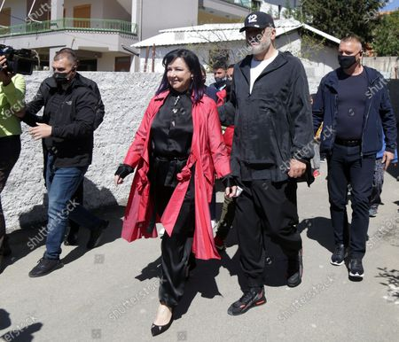 Albanian Prime Minister Edi Rama (C-R) and his wife Linda Rama (C-L) leave after casting their ballot at a polling station in Tirana, Albania, 25 April 2021. Albanians head to the polls on 25 April to vote in the parliamentary elections.