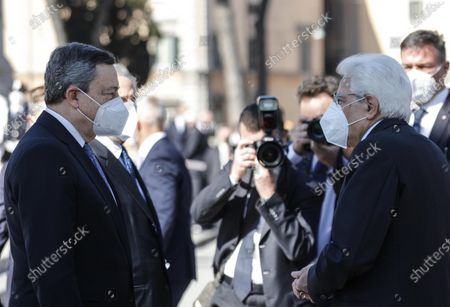 Italian Prime Minister Mario Draghi (L) and Italian President Sergio Mattarella (R) attend the celebration at the Tomb of the Unknown Soldier to mark the 76th Liberation Day, in Rome, Italy, 25 April 2021.