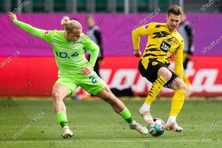 (210425) - WOLFSBURG, April 25, 2021 (Xinhua) - Lukasz Piszczek (R) of Dortmund lives with Xaver Schlager of Wolfsburg during a German Bundesliga match between VfL Wolfsburg and Borussia Dortmund in Wolfsburg, Germany, April 24, 2021.