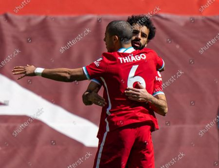 "(210425) - LIVERPOOL, April 25, 2021 (Xinhua) - Liverpool's Mohamed Salah (R) celebrates with his teammate Thiago Alcantara after scoring the goal opening the Premier League game between Liverpool and Newcastle United at Anfield in Liverpool, Britain, on April 24, 20 21. (Xinhua) FOR EDITORIAL USE ONLY. NOT FOR SALE FOR MARKETING OR ADVERTISING CAMPAIGNS. NO USE WITH UNAUTHORIZED AUDIO, VIDEO, DATA, FIXTURE LISTS, CLUB/LEAGUE LOGOS OR ""LIVE"" SERVICES. ONLINE IN-MATCH USE LIMITED TO 45 IMAGES, NO VIDEO EMULATION. SUN OUT. NO USE IN BETTING, GAMES OR SINGLE CLUB/LEAGUE/PLAYER PUBLICATIONS. - Xinhua -"