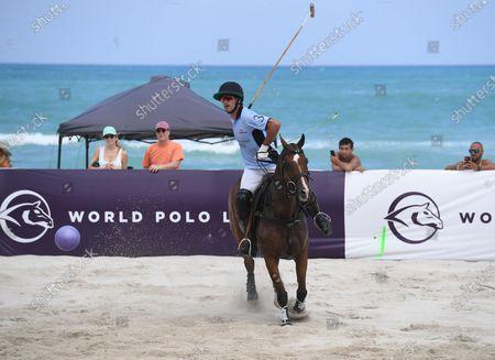 Nicolas Roldan of team GFI plays during The World Polo League Beach