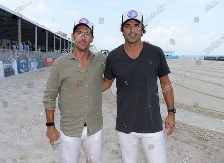 Nicolas Roldan and Nacho Figueras are seen during The World Polo League Beach