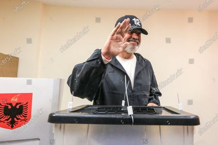 Albania's socialist party leader Edi Rama waves after casting his ballot during parliamentary elections in Surel, near Tirana, . Albanians are voting in parliamentary elections amid the virus pandemic and a bitter political rivalry between the two largest political parties. Some 3.6 million eligible voters, including Albanians overseas, will elect 140 lawmakers among some 1,800 candidates from 12 political parties or coalitions and those running independently